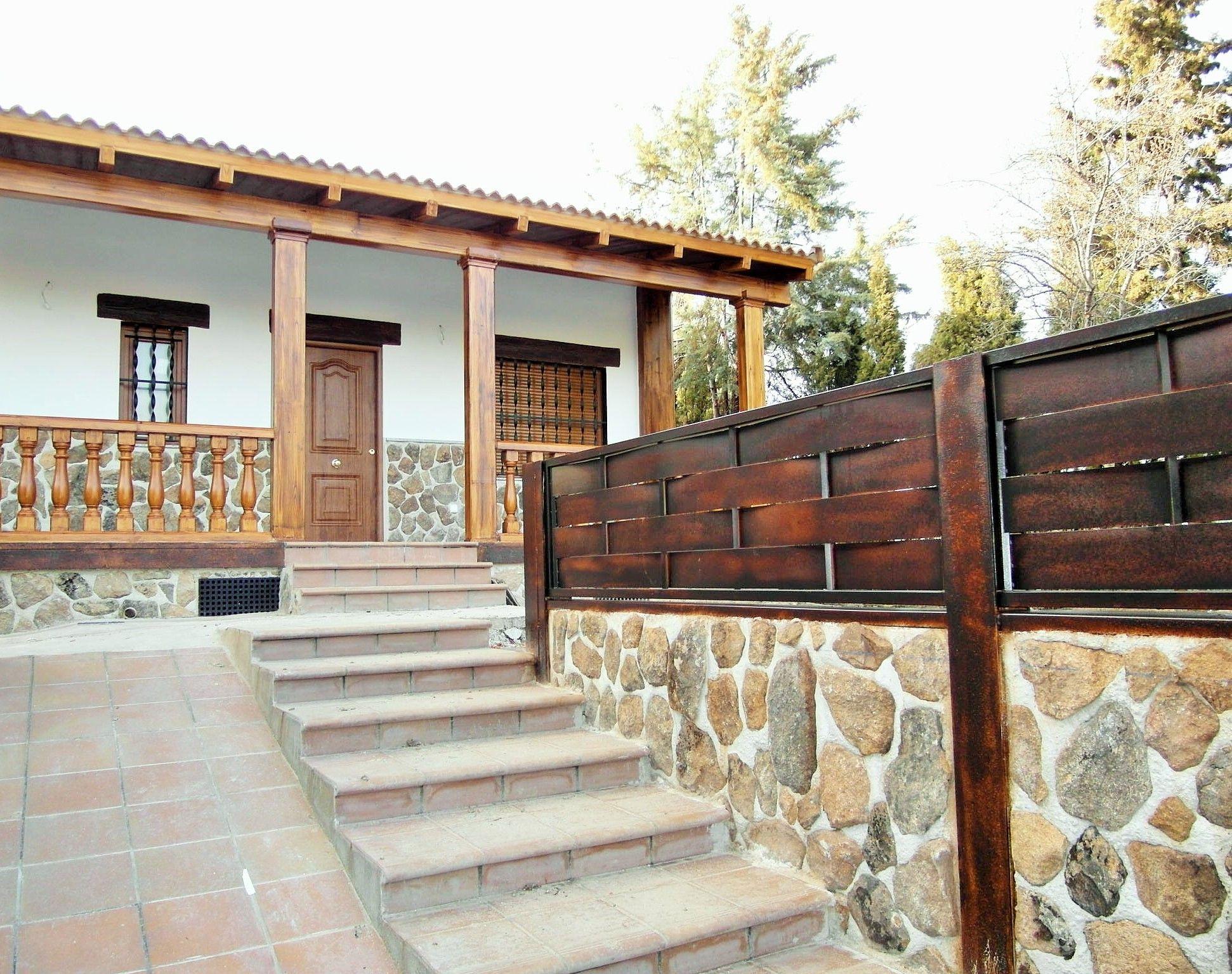 Muro de carga en casa prefabricada de campo con acabado de cerramiento www Cerramientos de piedra