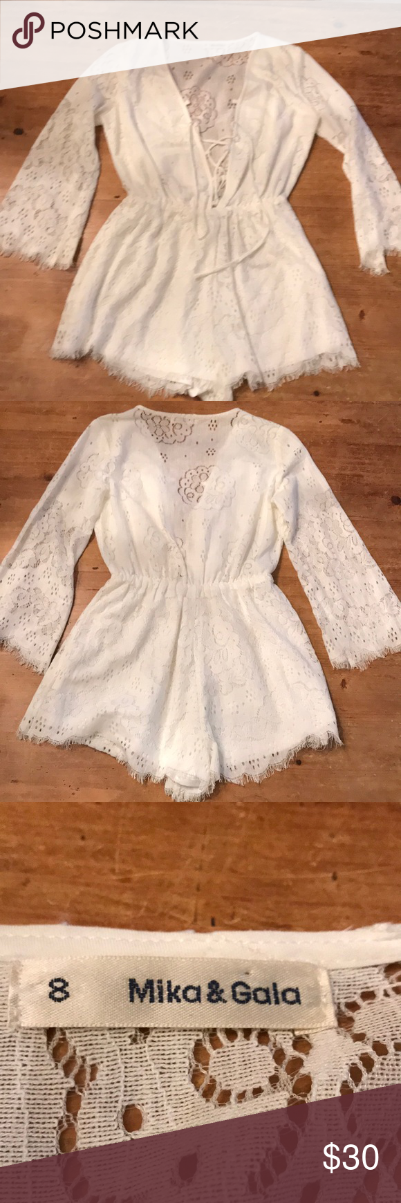 4962b89a838 LF  Mika   Gala lace romper Gorgeous white lace romper from LF. Lace up in  the front. Bell sleeves and elastic waist. Size 8   medium. Never worn!!