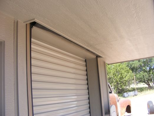 Screen designed to roll up in ceiling garage screen for Roll up screen door for garage