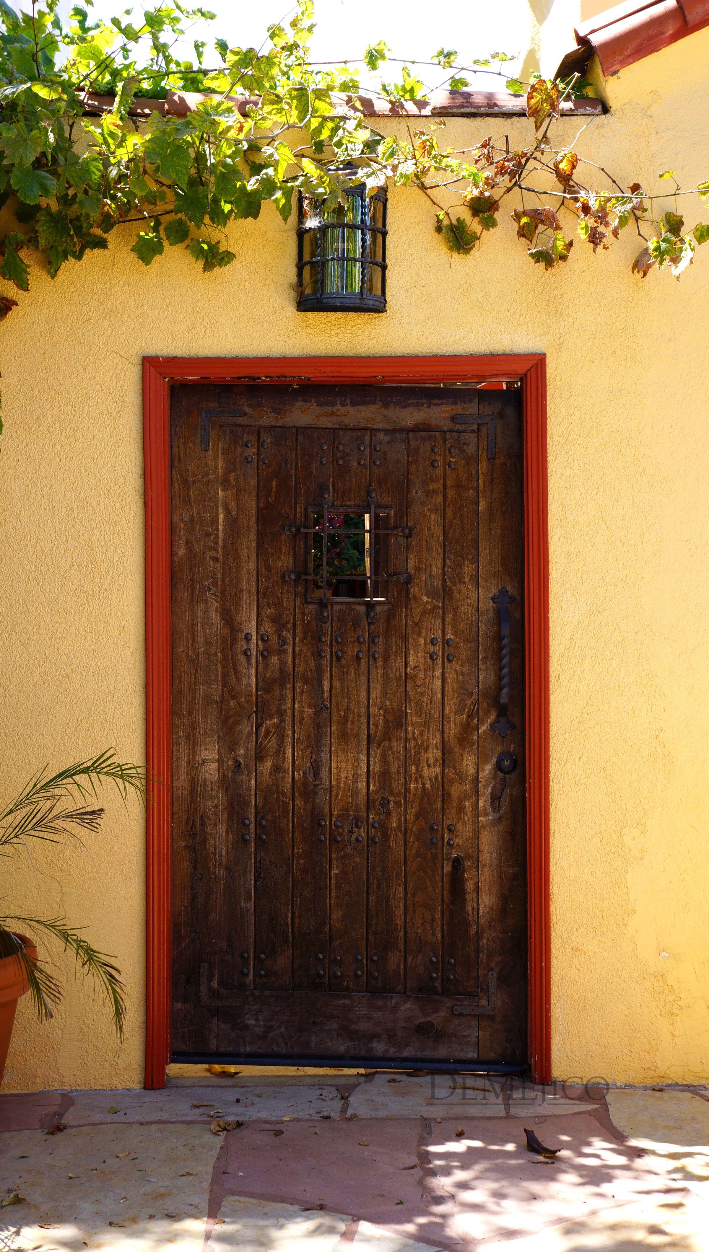 Gorgeous Spanish Gate Luscious Green Vines Bright Yellow Wall