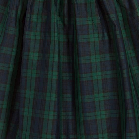 A Beautiful tartan dress , the textured ribbon and delicate bow around the front of the bodice gives a finishing touch. The dress is fully lined and has a zip fastener at the back, the gathered skirt has a net underneath to give extra fullness. Perfect for Christmas, Birthday parties and special occasions. A beautiful addition to your little ladies' wardrobe.Made In England - This item is made and ready to ship.This dress is available in the following sizes -Newborn (up to 16
