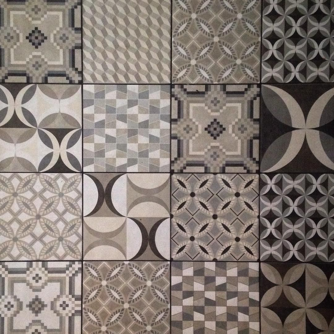From A Patchwork Quilt On Bed To Floor Tiles