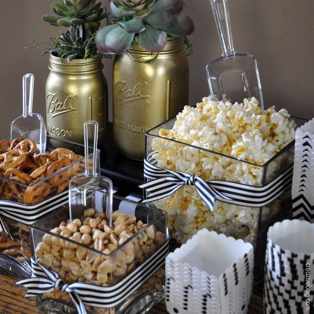 use glass containers for peanuts, pretzels and popcorn at the bar ... add scoops and paper containers for guests to help themself! #moms50thbirthday