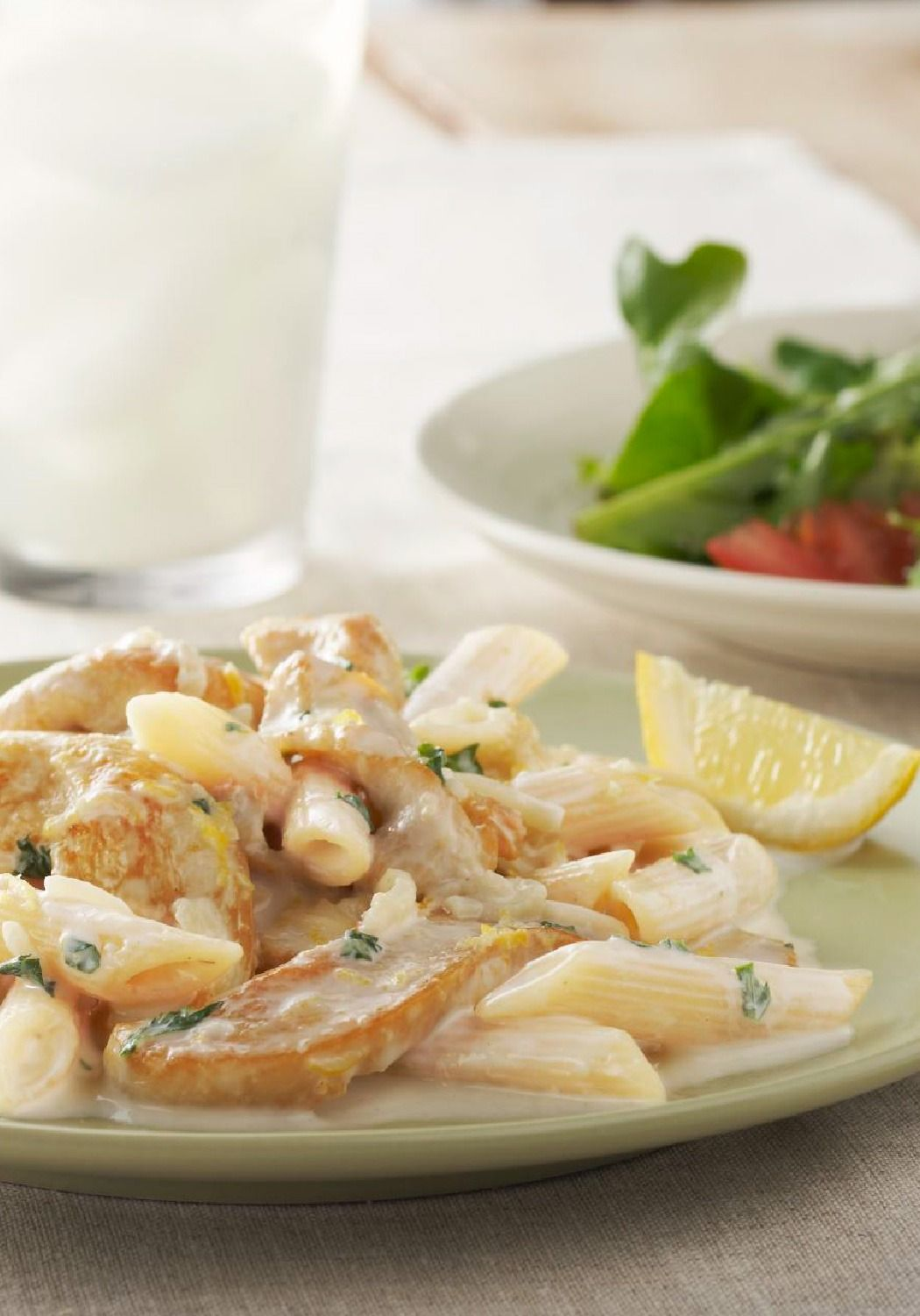 Creamy Lemon Chicken Pasta – Cheesy, creamy and brightened by lemon zest, this chicken and penne pasta dish tastes amazing—but takes less than 40 minutes to make!