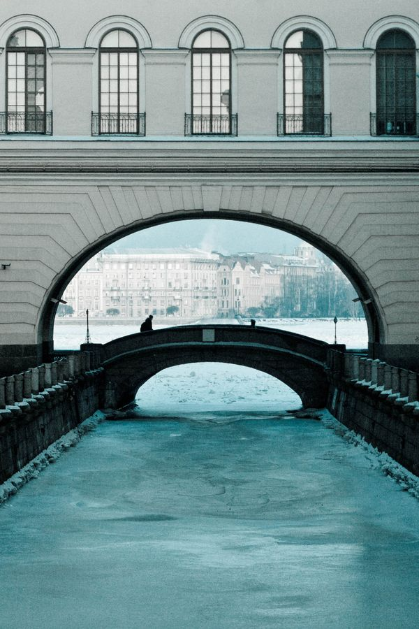 Channel to Big Neva River, Saint Petersburg, Russia ~ The hallway above connects parts of the Winter Palace with one another. We sailed under the arches on a boat tour of Petersburg; here the canal is iced up. It leads to the Neva.