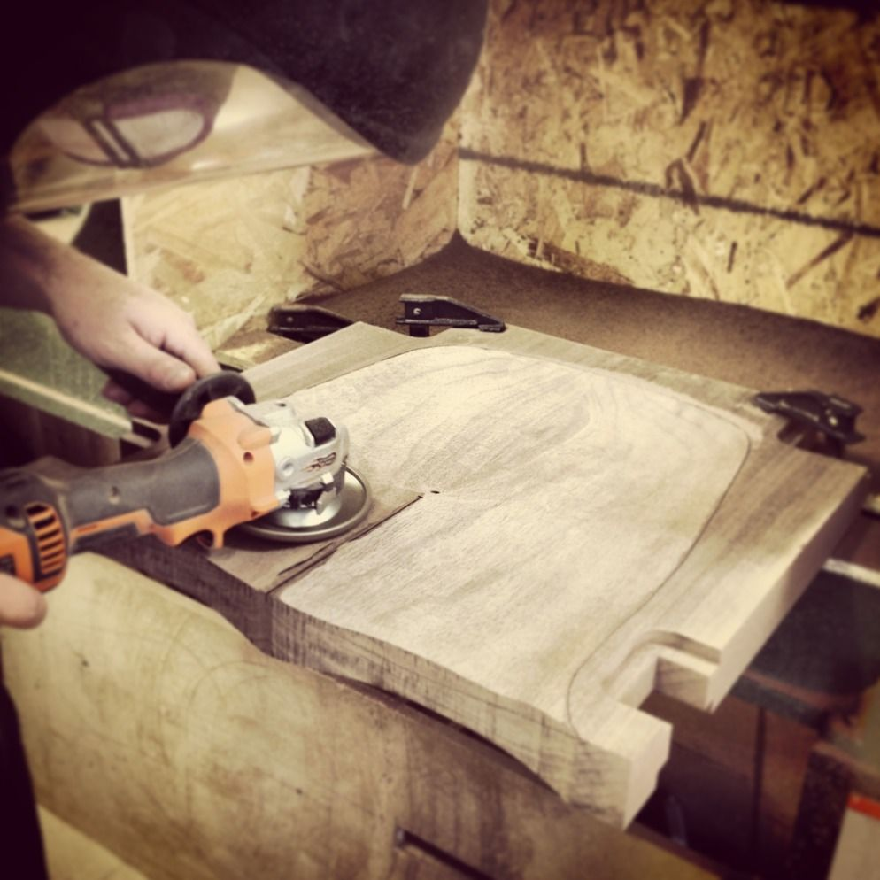 Thomas De Lussac Hand Carving A Walnut Bar Stool Seat With An Angle Grinder