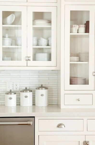 Lovely kitchen with silvery gray linear glass tile backspalsh white shaker front also