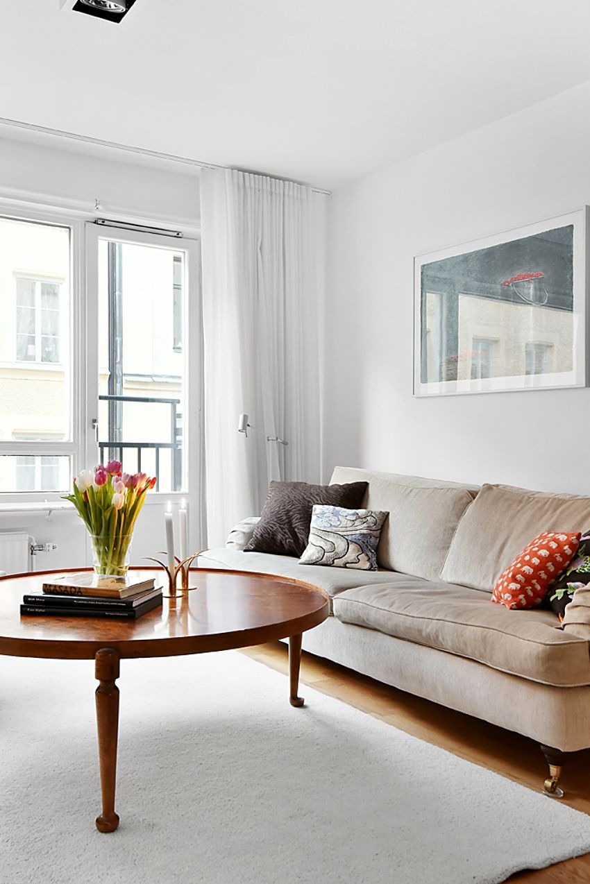 Living room with beige Howard couch, Svenskt Tenn cushions, coffee ...