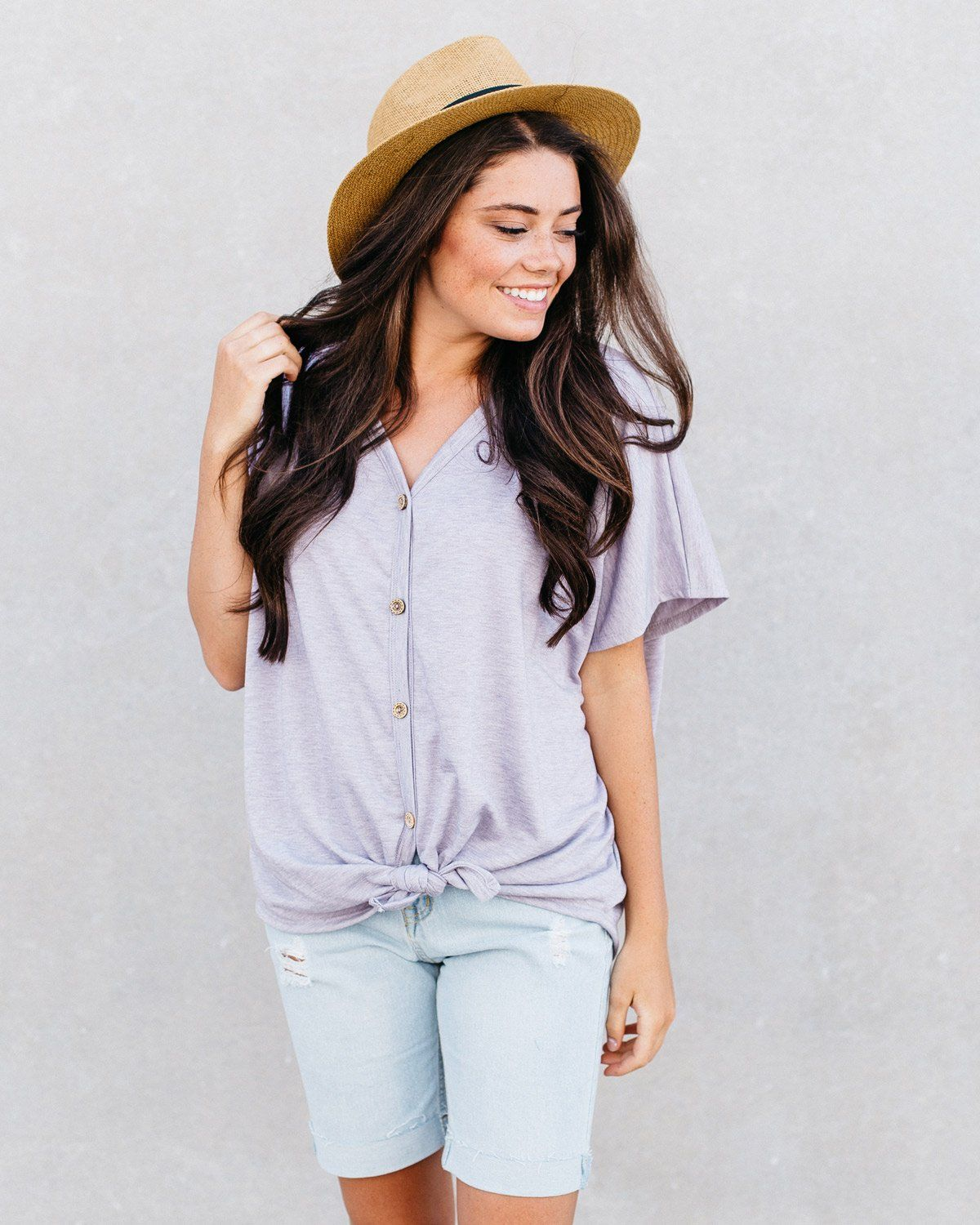 e7e94602 Jolie Button-Down Knotted T-Shirt This oversized v-neck shirt buttons up