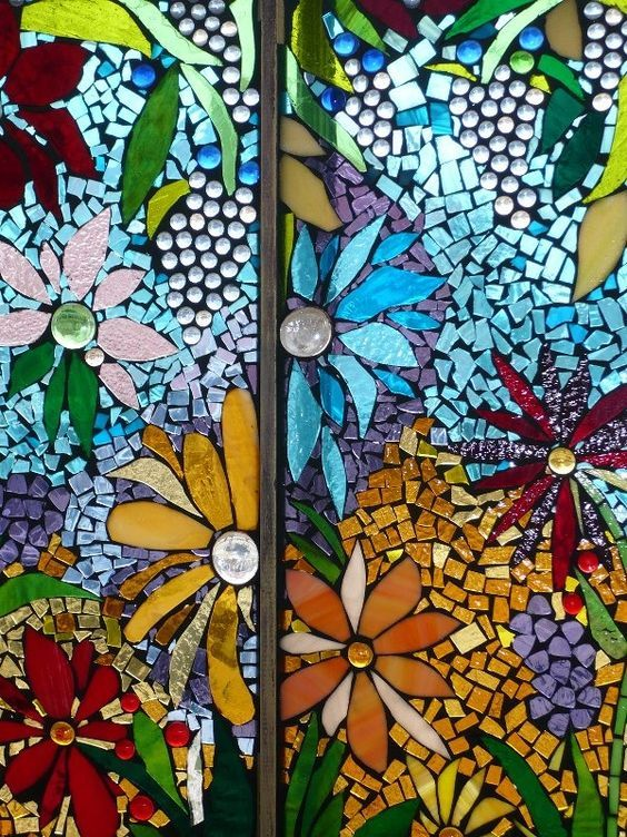 A Mosaic Made Of Pieces Of Stained Glass Glued Onto A