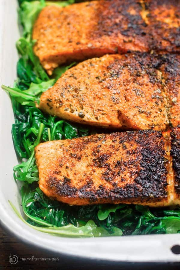 Pan Seared Salmon with Orange Juice, Wilted Spinach and Arugula #salmonrecipes