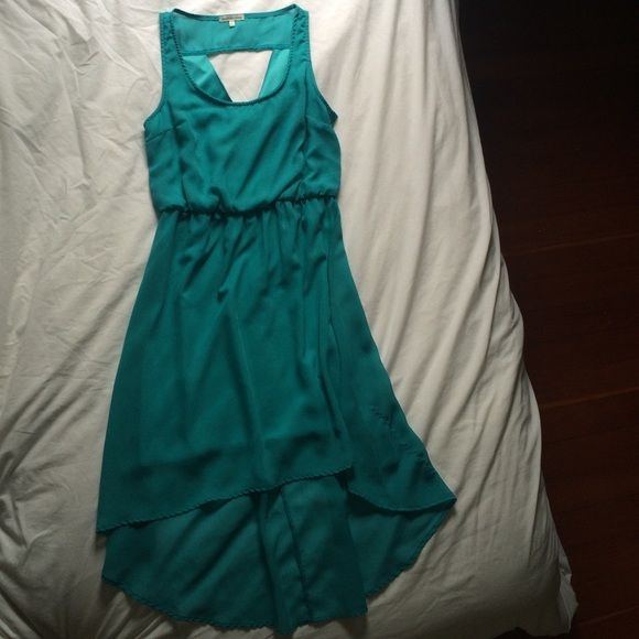 Blue dress from Charlotte Russe Blue dress with a high low hem. Back has a triangle cutout. In very good condition. Charlotte Russe Dresses High Low