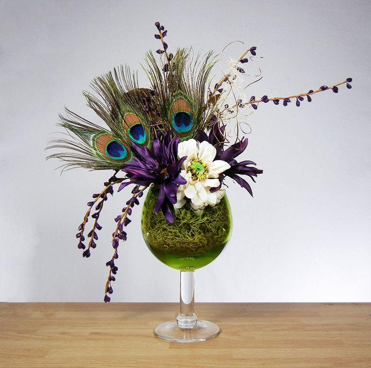 Peacock flower arrangements wedding