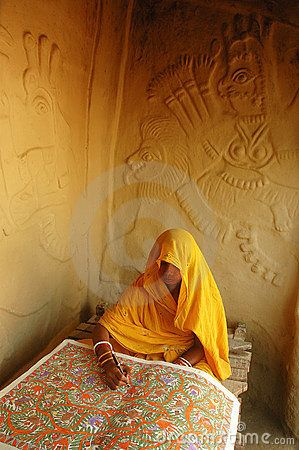 A Mithila woman working on her Madhubani Painting