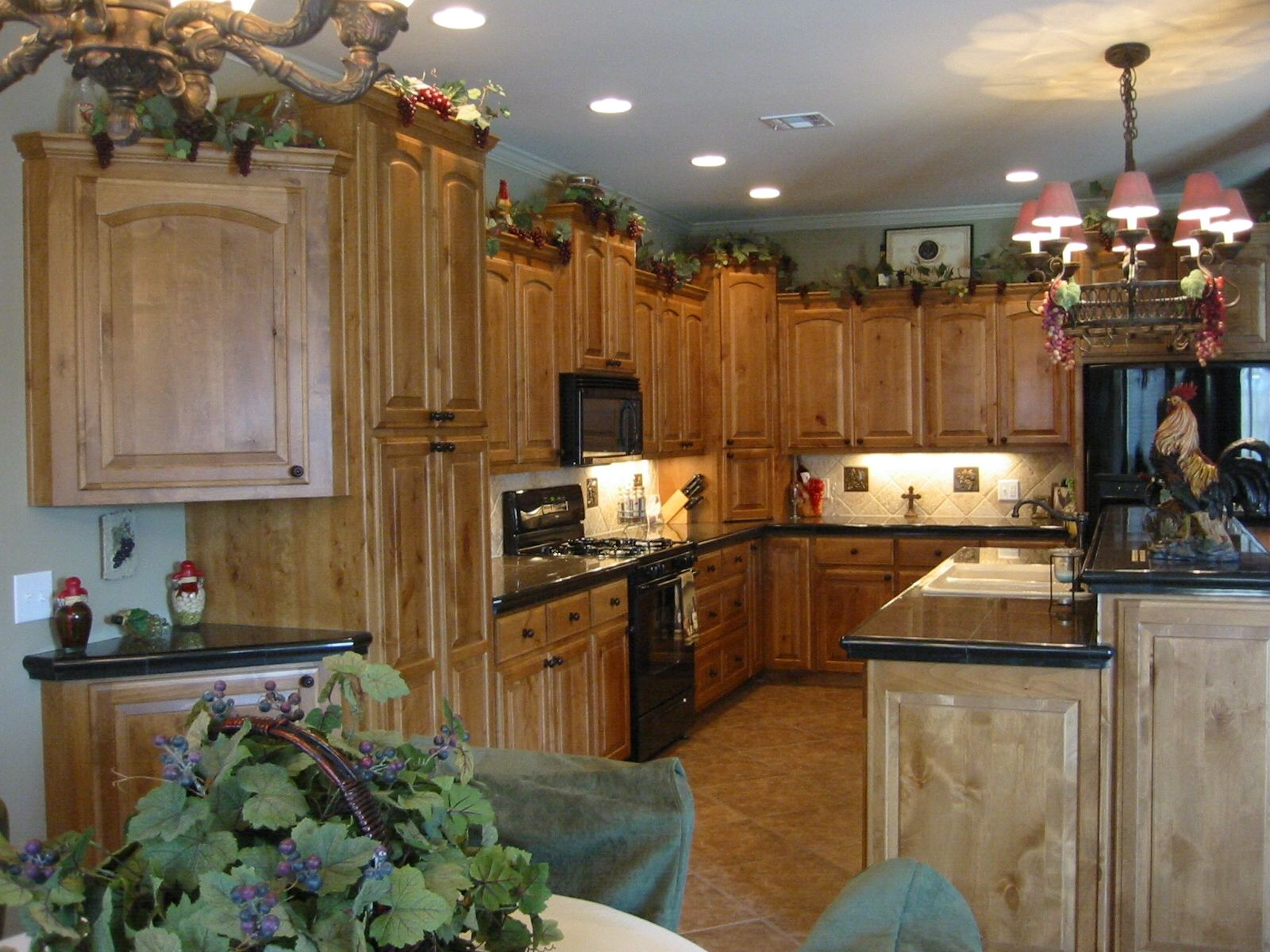 Knotty Alder Cabinets with Fruitwood Stain | Kitchen wall ...