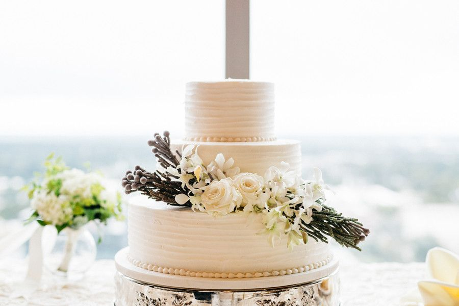 Fall wedding cake idea - classic round, three-tier wedding cake decorated with roses, orchids, and brunia berries. {Rebecca Ames Photography}