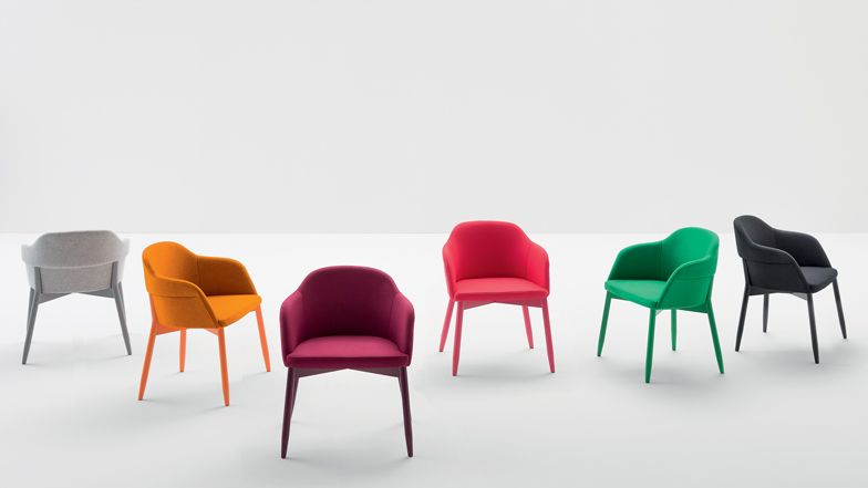 Spy by Emilio Nanni for Billiani This simple armchair with a wooden base and upholstered body by Italian designer Emilio Nanni will debut in Milan next month. Nanni designed Spy to highlight the connection between the chair's soft top and hard bottom.