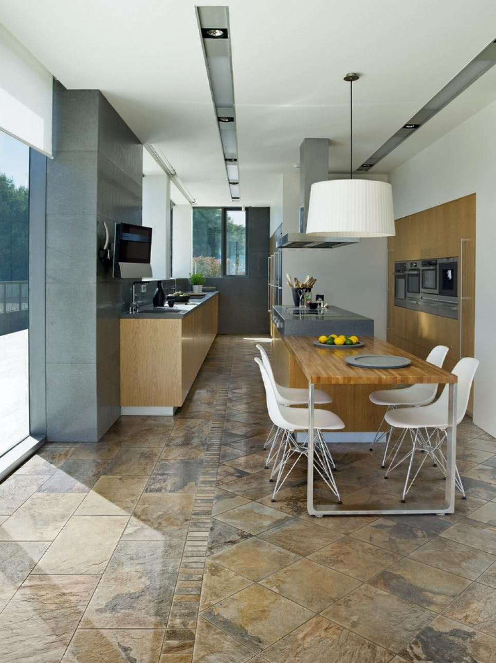 Porcelain tile works well in kitchens find a colour that works well with your cabinets and countertops