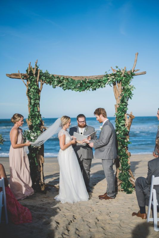 Jacquelyn kyle southern hospitality wedding highlights video driftwood arch with greenery garland greenery swag greenery garland driftwood arch beach junglespirit Gallery