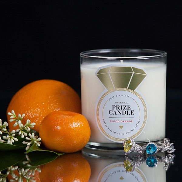 Bloodorange CANDLE    An energizing, fresh citrus scent with elements of mandarin and blood orange reveals a picturesque citrus grove nestled on an Italian hillside.