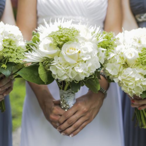 Instead of having a florist design the flower arrangements for the wedding day, Briana ordered her white roses, white and green hydrangeas, spider mums, queen anne's lace from Costco and arranged the flowers herself with the help of her friends in order to save money.  -  Image Credit: Fairy Tale Photography