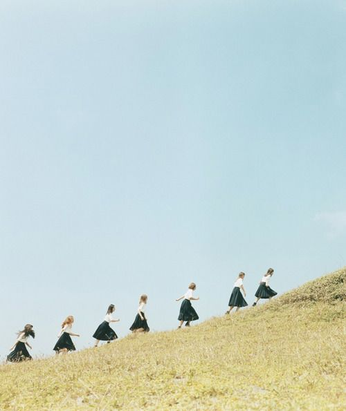 girls walking up a hill... by Osamu Yokonami