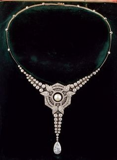 An important Art Deco necklace, by Maison Briquet, Place Vendôme. The necklace centring a fine pearl in a fine openwork geometrical Art Deco setting surrounded by brilliant-cut diamonds, suspending a pear-shaped diamond mounted in white gold.