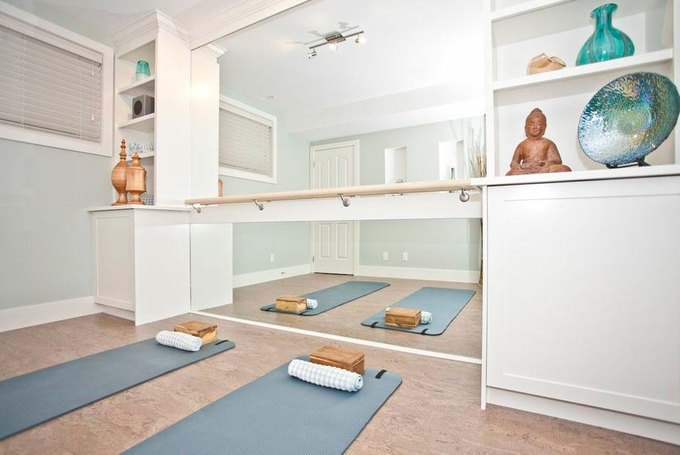 Home Yoga Studio Design Ideas yoga studio design with brick walls large windows and dark floor Luxury Yoga Roomjpg