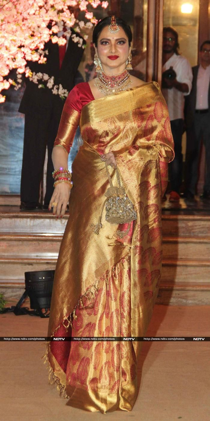 f0e248fc1d20b1 Actress Rekha, dressed in her usual kanjivaram sari, glittered at the do.
