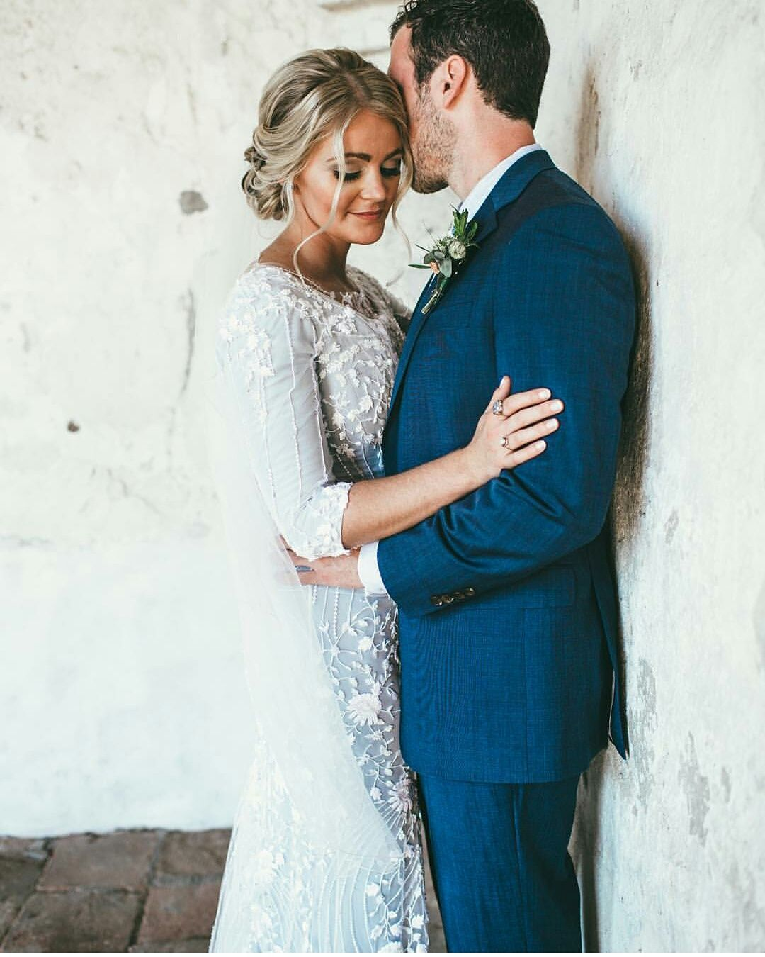 Modest wedding dress with three quarter sleeves from alta moda
