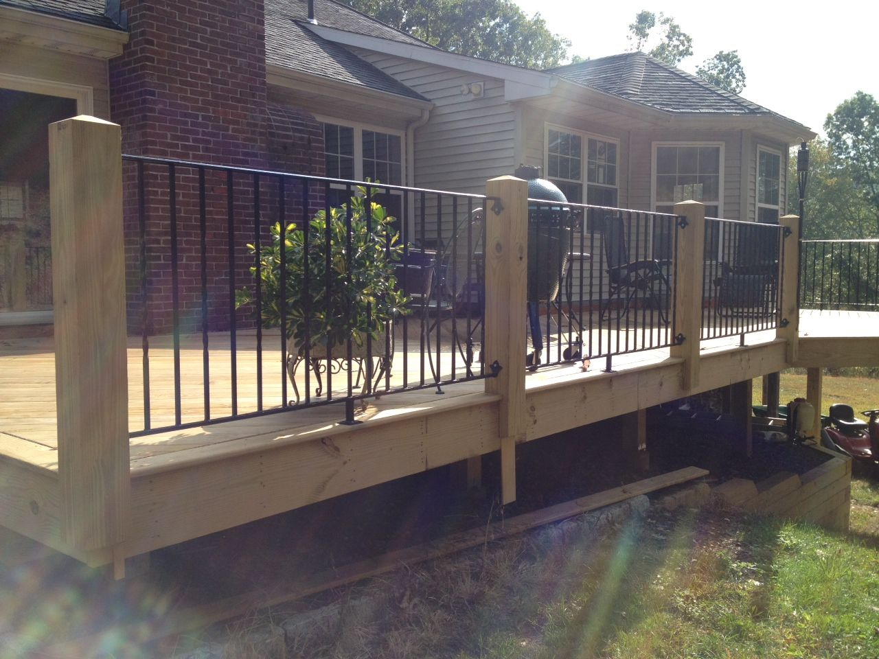 Wood Posts And Wrought Iron Hand Rails Pickets