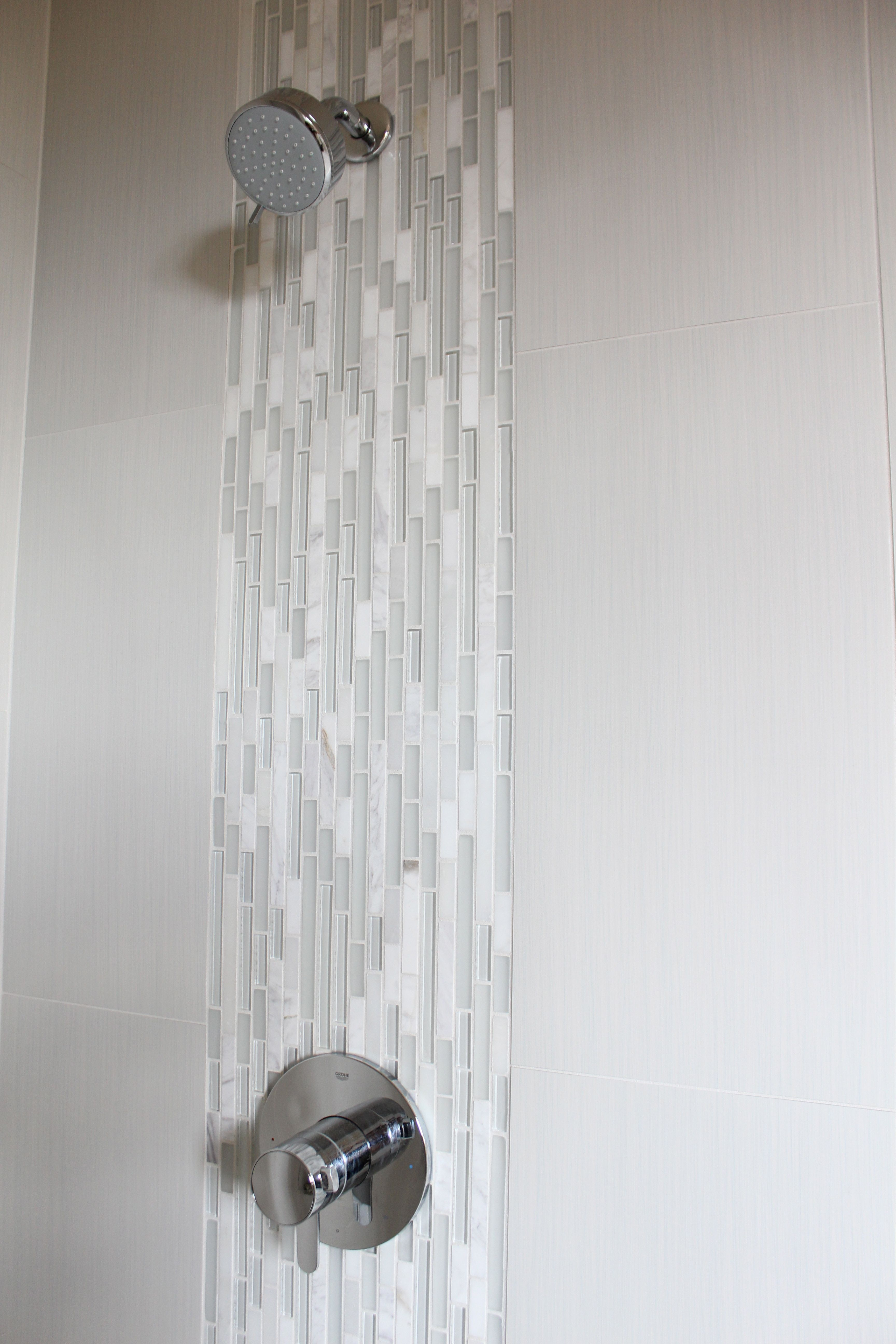 Waterfall Detail In Master Shower Emser Tile 12x24 Strands In Pearl Vertically Stacked With