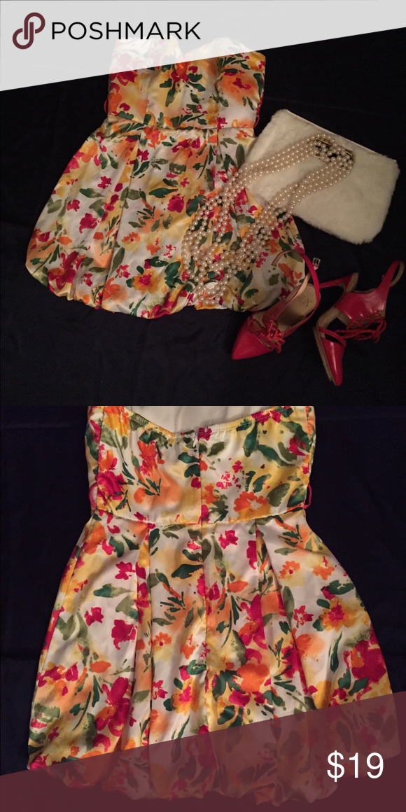 Beautiful Floral Print Bubble Dress Vibrant colors of orange, red, yellow, and green on cream background. Hidden zipper. Strapless. No belt. Fully lined. 100% Polyester . Length 26 inches. Beautiful and versatile ! twentyone Dresses