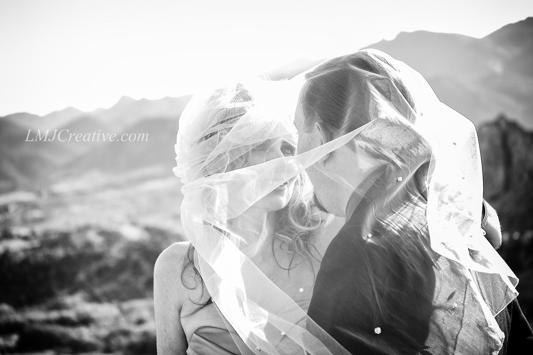 Corey and Shela under her windy veil, after their wedding