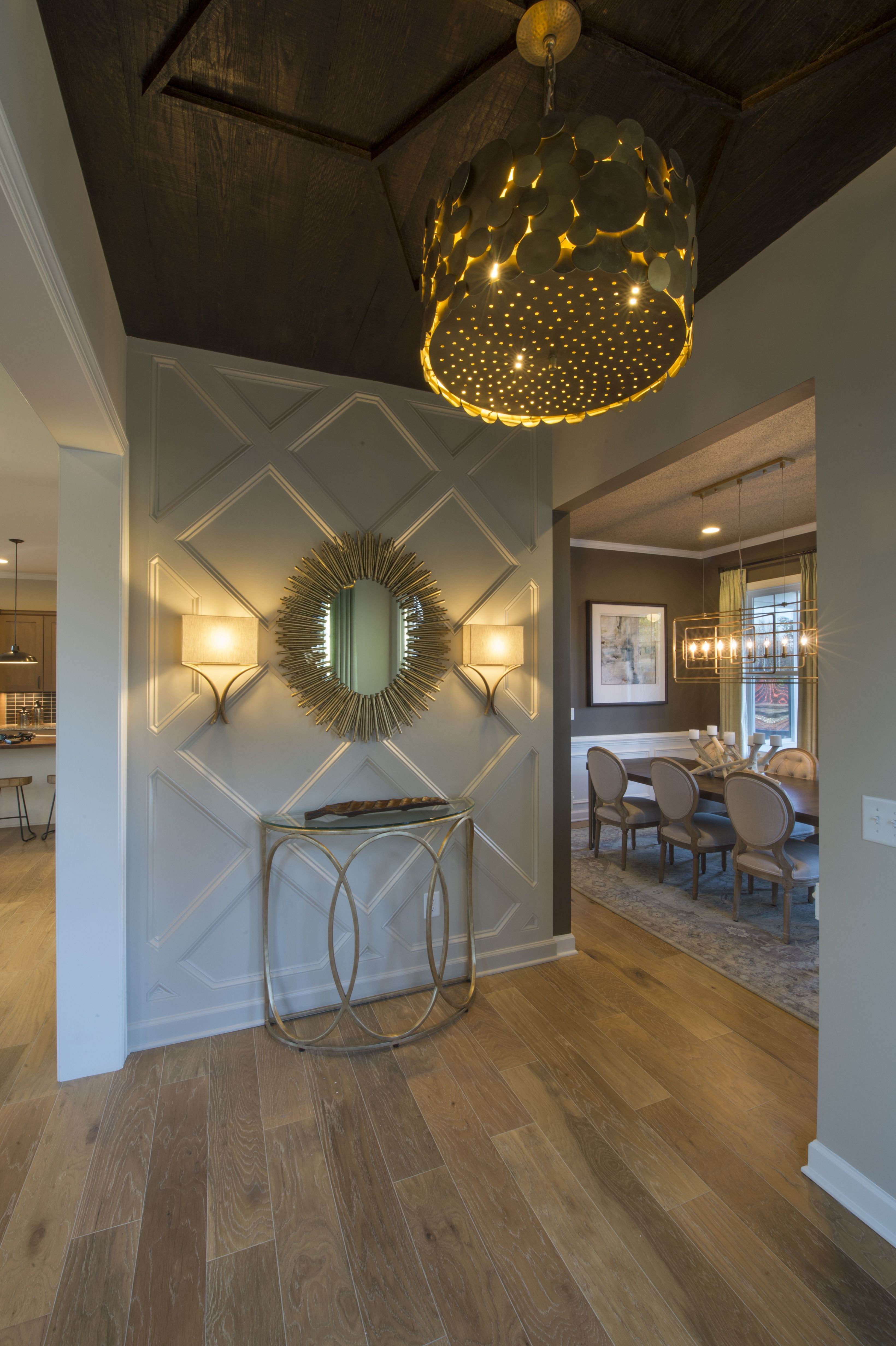A Geometric Accent Wall Gold Starburst Mirror And Large Bold Light Fixture Adds Dimension Drama And Accent Wall Entryway Starburst Wall Decor Entryway Wall