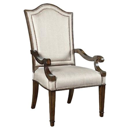 Showcasing a wood frame and nailhead trim, this lovely arm chair is perfect pulled up to your kitchen or dining room table.  Product...