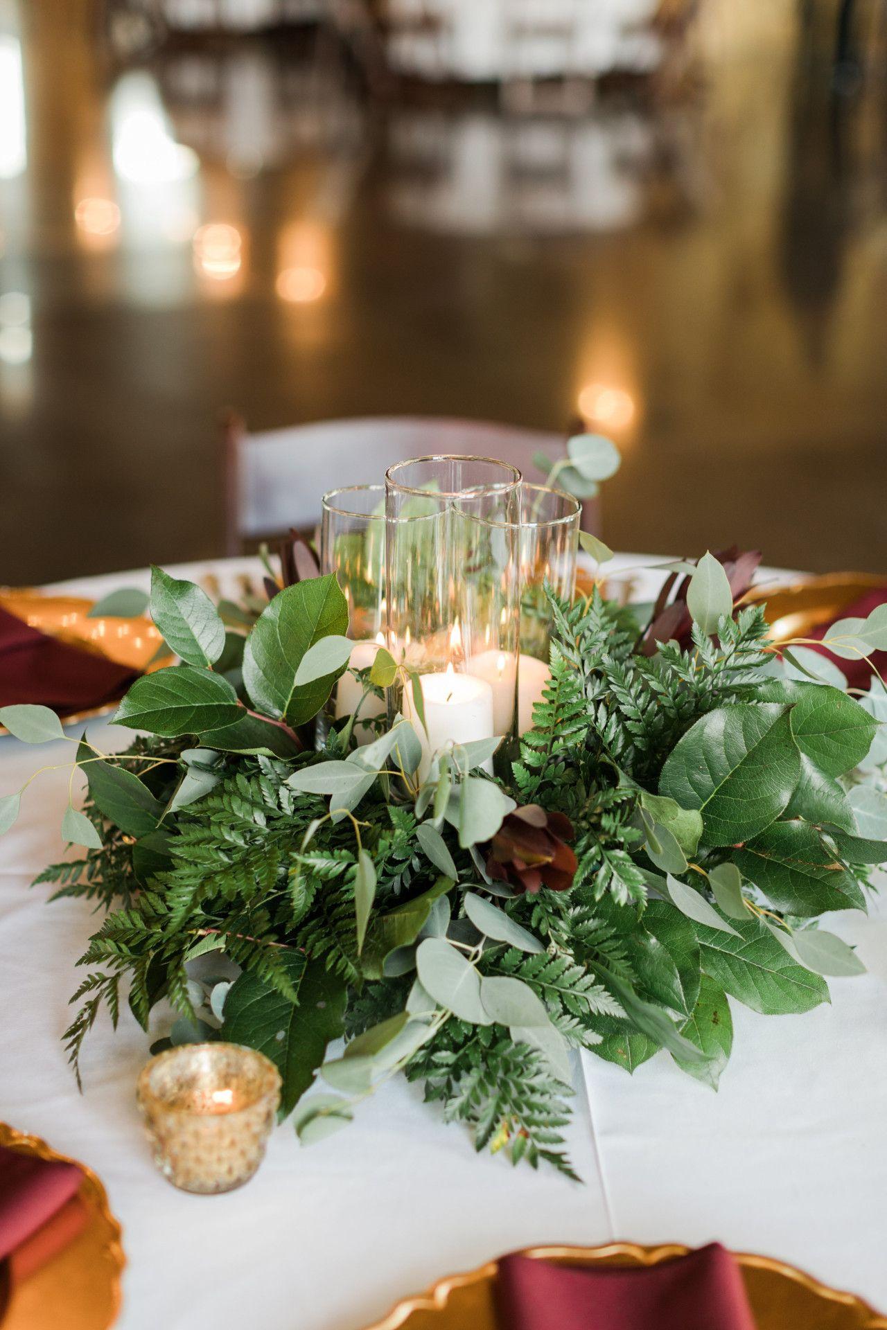 Wedding decor maroon  wedding centerpiece with greenery  candles  elegant wedding