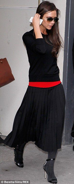 f7c96badd Victoria Beckham commits fashion faux pas in woolly tights and ...