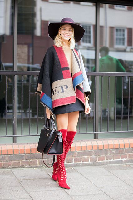 How To Wear Tall Boots & Look Damn Fine #refinery29  http://www.refinery29.com/tall-boots-outfits#slide2  A pair of red-hot lace-up boots demands drama elsewhere, try a poncho coat and wide-brimmed hat for an awesome autumn look.