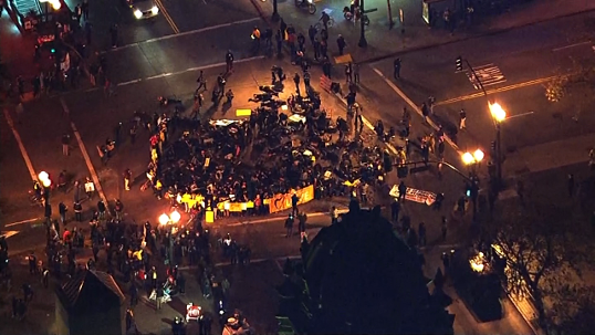 Protesters gather in Oakland after a St. Louis County grand jury declined to indict a Ferguson officer in the deadly shooting of Michael Brown. (Nov. 24, 2014)