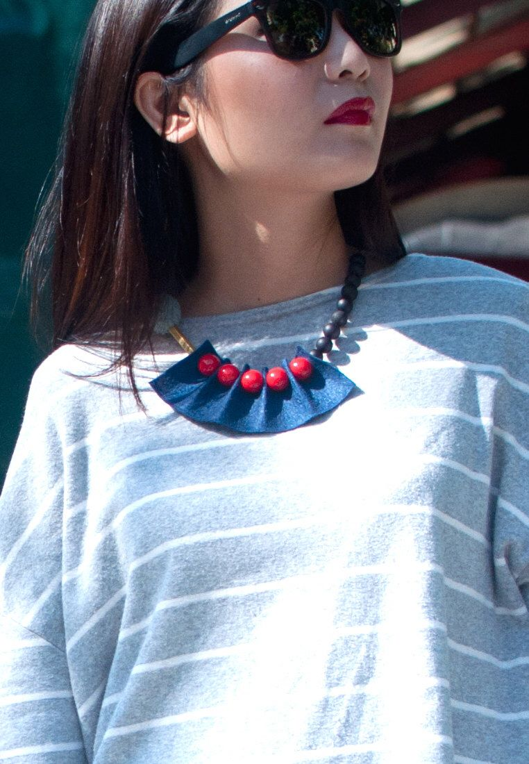 A personal favorite from my Etsy shop https://www.etsy.com/listing/223866507/blue-red-felt-resin-ball-necklace