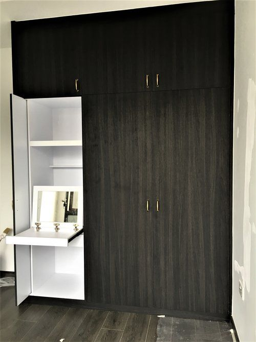 Built In Dresser With Retractable Wardrobe Door A Pull Out Table Top Fitted With A Mirror That Doesn T Dis Wall Wardrobe Design Wardrobe Wall Built In Dresser
