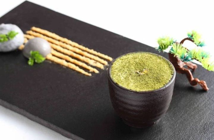 """Vicky Lau creates """"edible stories""""-- this zen garden is made of matcha mousse, panna cotta, and peanut """"sand""""."""