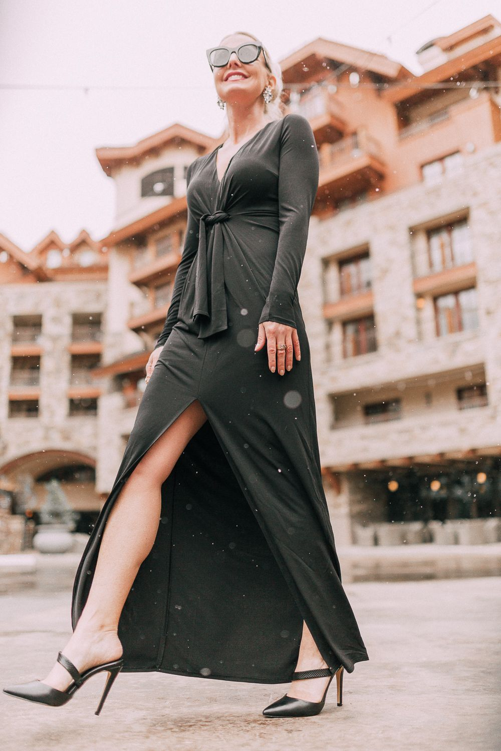 853f1d1d6da Unexpected holiday party outfits featuring a long black maxi dress with high  slit to show off