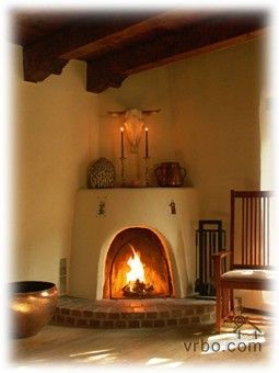 orange-brown kiva on white walls | kiva fireplaces | Pinterest ...