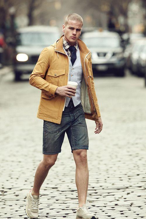 Shop this look on Lookastic: http://lookastic.com/men/looks/long-sleeve-shirt-tie-waistcoat-shorts-athletic-shoes-field-jacket/9599 — Tan Plaid Long Sleeve Shirt — Navy Polka Dot Tie — Grey Waistcoat — Charcoal Denim Shorts — Beige Athletic Shoes — Mustard Field Jacket