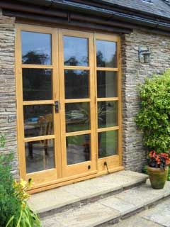 Oak Doors with Glass Panels handmade by Devon Heritage Joinery.