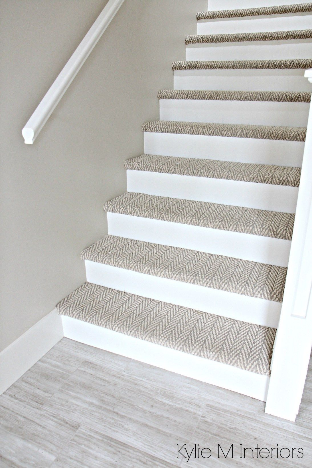 The 3 Best NOT BORING Paint Colours to Brighten Up a Dark Hallway     Stairs with carpet herringbone treads and painted white risers  looks like  a runner  Benjamin Moore Edgecomb Gray on stairwell wall