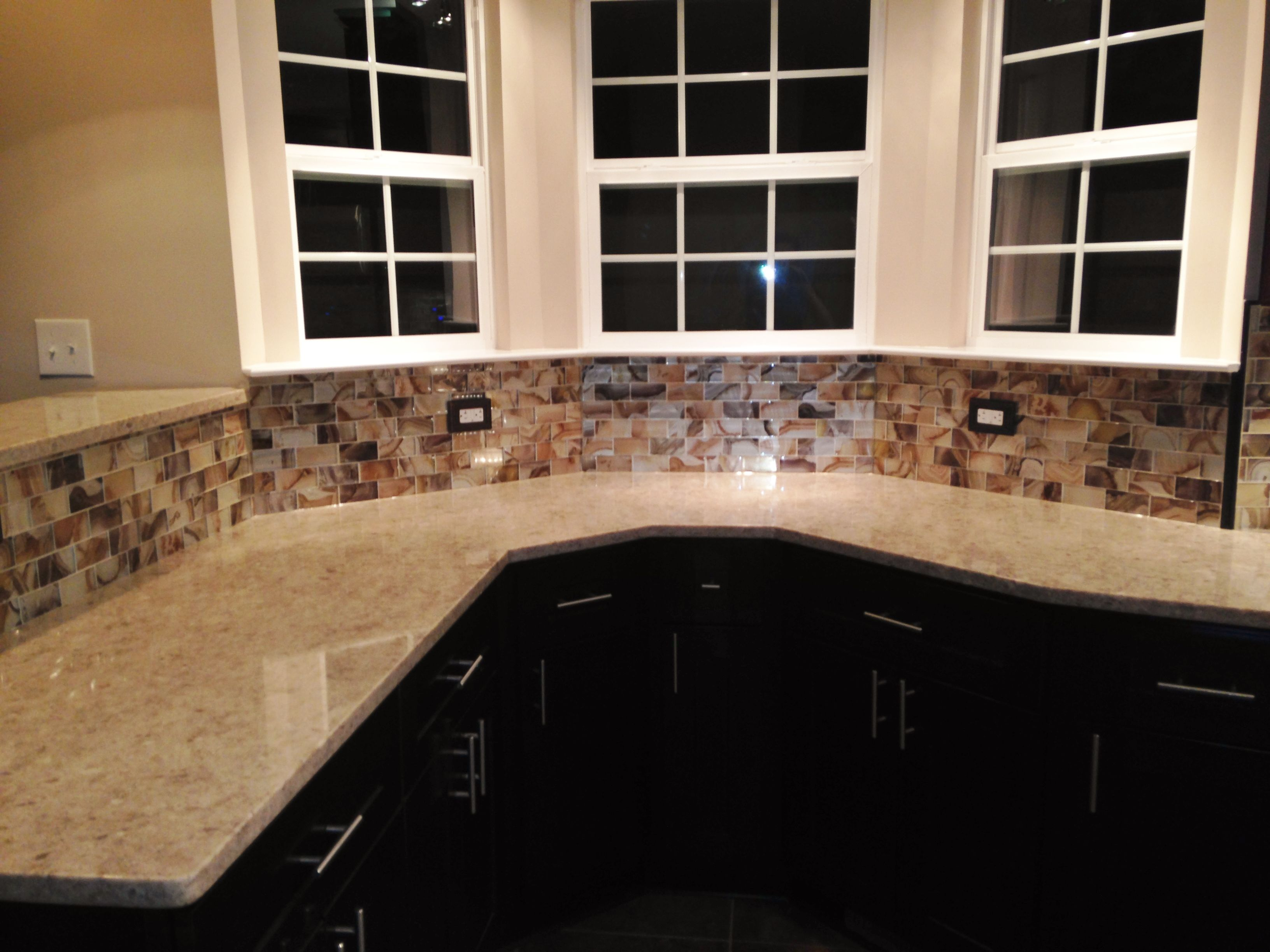 kitchen remodel- curved silestone countertop, glass backsplash