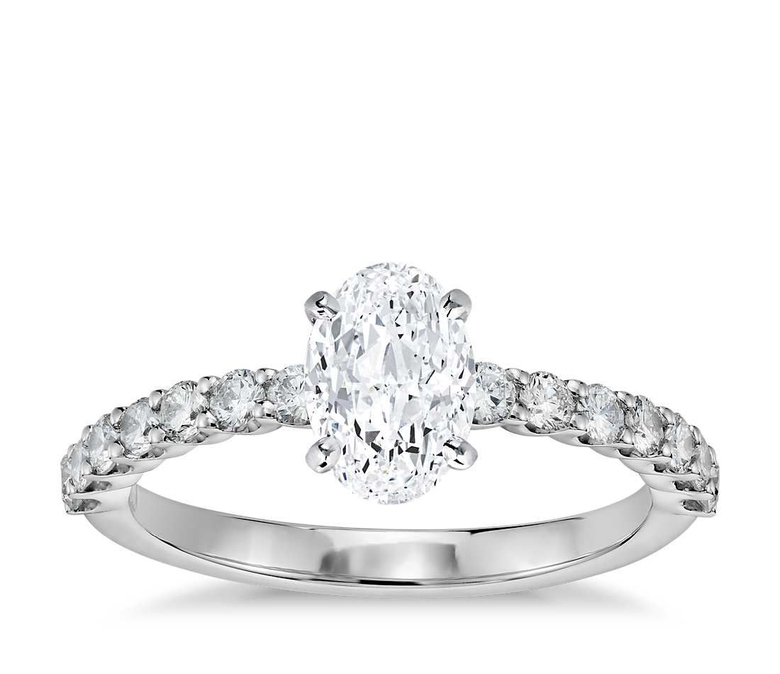 Exquisite in design, this diamond engagement ring features a delicate row of shared-prong set diamonds to beautifully frame your center diamond. Setting includes 1/3 carat total diamond weight.